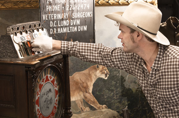 Corb Lund investigating one of the artefacts in the exhibition