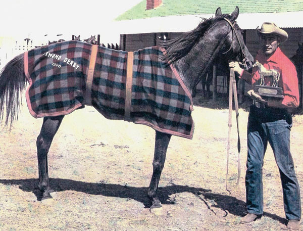 Rufus Goodstriker with one of his race horses, Whistling Fred, after winning the Raymond Businessmen's Derby in 1960