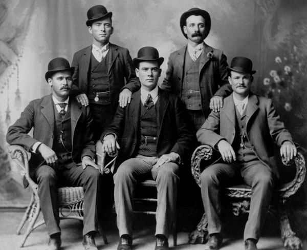 The Wild Bunch?Front row left to right: Harry A. Longabaugh, alias the Sundance Kid, Ben Kilpatrick, alias the Tall Texan, Robert Leroy Parker, alias Butch Cassidy. Standing, from left: Will Carver, Harvey Logan, alias Kid Curry. Fort Worth, Texas, 1900