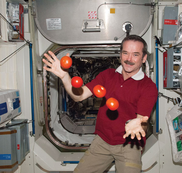 Commander Chris Hadfield juggling tomatoes in space. Photo courtesy Chris Hadfield.