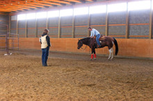 "Donna Quinn's 60""x 90"" indoor arena was constructed in 2009. Donna is especially happy with the translucent light panels installed high on both long walls, and the heavy kickboard made of 1"" plywood. Photo by Donna Grovet."