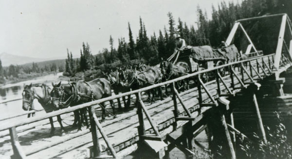 Earl Buck crossing a bridge with his freight wagon pulled by a six-horse hitch. Photo courtesy Daryl Drew.
