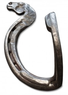 A hook with a forged horse head for decoration