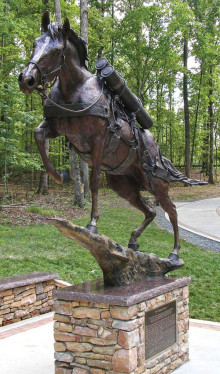 The statue of Staff Sergeant Reckless, Marine Corp, by sculptor Jocelyn Russell shows the mare carrying ammunition shells and other combat equipment. It was unveiled July 26, 2013, in Semper Fidelis Memorial Park at the National Museum of the Marine Corps in Virginia. There is a lock of her tail hair in the base of the statue. Photo courtesy United States Marine Corp.