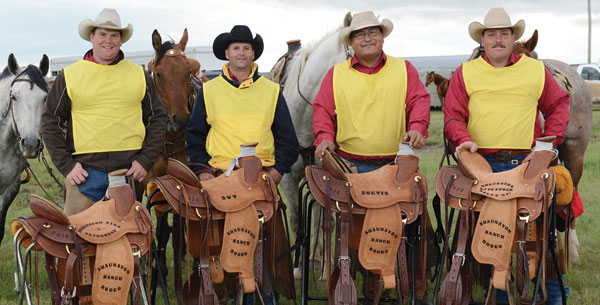 Back-to-back Champions FWDP. From left: Ross Davidson (captain), Riley Pritchard, Shawn (Shawn-Boy) Francis and Chris Williamson with their 2014 trophy saddles. Photo courtesy of Shaunavon Ranch Rodeo.