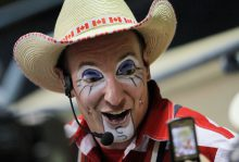 Crash Cooper, a Canadian rodeo clown, gets his photo taken during the Ram National Circuit Finals Rodeo at the State Fair Arena in Oklahoma City, Saturday, March 31, 2012. Photo by Garett Fisbeck, For The Oklahoman