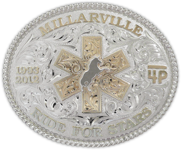 Custom made for Lara Palmer by the Millarville Ride for Stars, this sterling silver and 10kt gold buckle is completely engraved by hand.