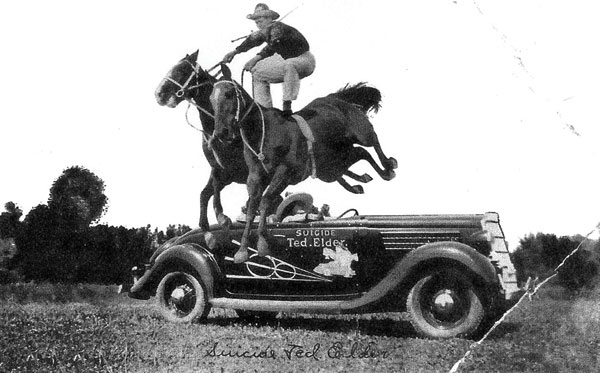 Roman-riding while jumping one of his signature Ford vehicles. Photo courtesy Raymond Museum.