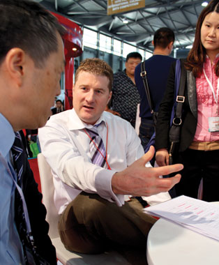 CBI president Rob Meijer passionately discusses Canadian quality with a qualified Chinese buyer.